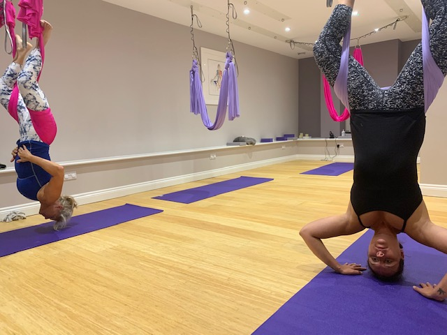 Student Practising aerial inversions on the silks.